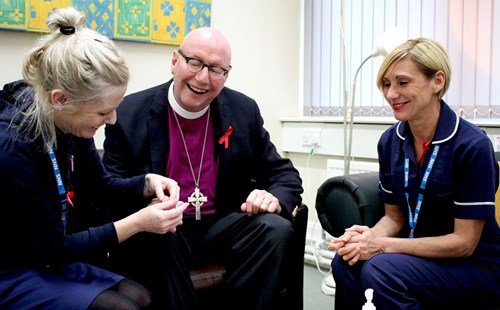 Bishop Paul Bayes takes part in a finger-prick test