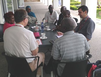 Professor Harding (l) and Dr Ben Turner (R) meet members of the  Malawi Diabetes Association