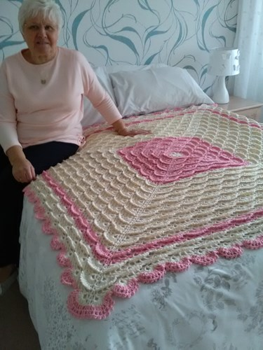 Mill Quigley with one of her crocheted blankets