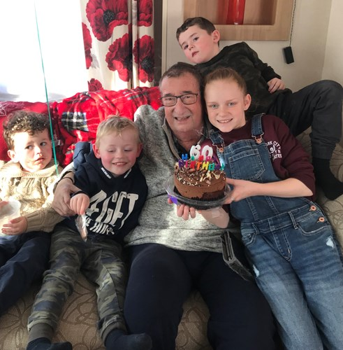 Paul with his grandchildren on his 60th birthday last year
